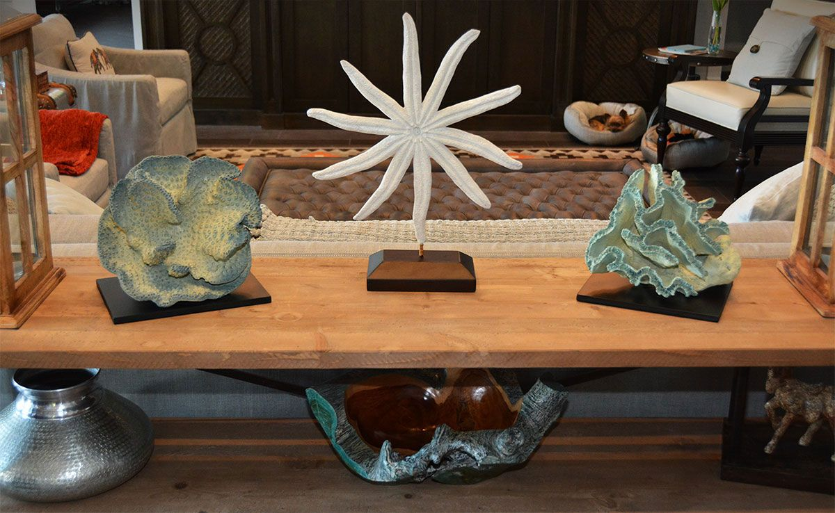 Beautiful Interior Setting Featuring Handcrafted Nautical Accessories Stone Casted Sunflower Starfish On Stand Between Blue Broach C And Sponge