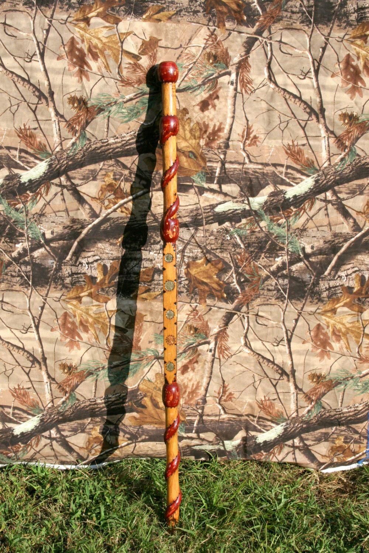 Handcarved Walking Cane -Burgundy swirl and money design by WestWorkmanship on Etsy https://www.etsy.com/listing/164323300/handcarved-walking-cane-burgundy-swirl