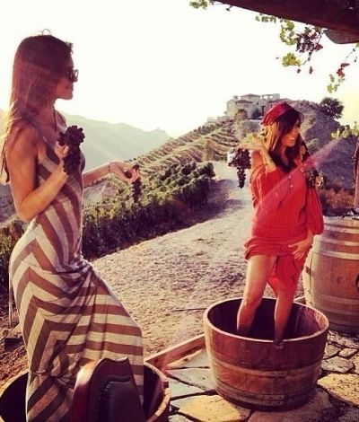 Kourtney Kardashian and Kendall Jenner at a vineyard. Grape stomping...