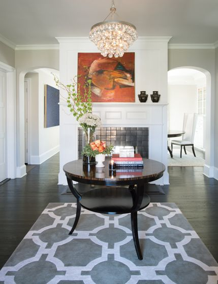 Mike Johnson, from Lori Graham Design + Home, mixes a Beauvais Carpets #rug with a Robert Abbey #chandelier in the #foyer. #interior #design #fine #furnishings