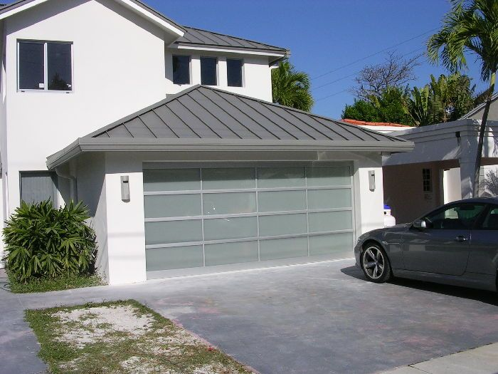 Although The Strength Of Garage Doors Is A Significant Concern In High Wind Conditions Many People Simply Are Glass Garage Door Garage Doors Residential Doors