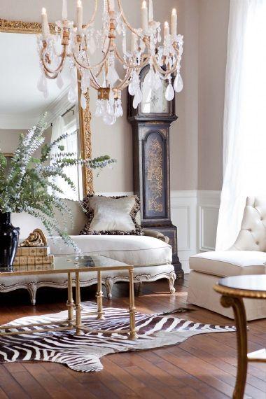 Rock crystal chandelier gold leaf mirror zebra rug this - Gold rugs for living room ...