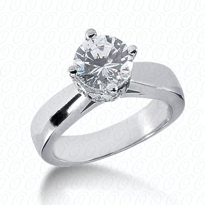 14k white gold solitaire engagement ring with diamonds around head and offset round stone available at Wheat Jewelers