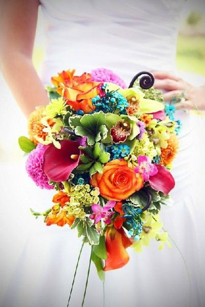 Rich With Orchids Calla Lilies Freesia Hydrangea And Accented With Fern Curls And Draping Grasses This Bouquet Will Set This Bride Apart Rainbow Bouquet Wedding Cakes With Flowers Wedding Bouquets