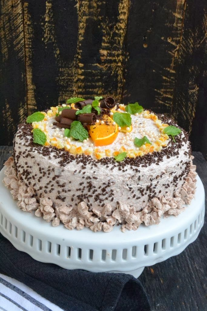 Orange Cake with Chocolate Whipped Cream isvery moist and soft and the frosting light and airy. The candied orange peel gives it a slight tang.