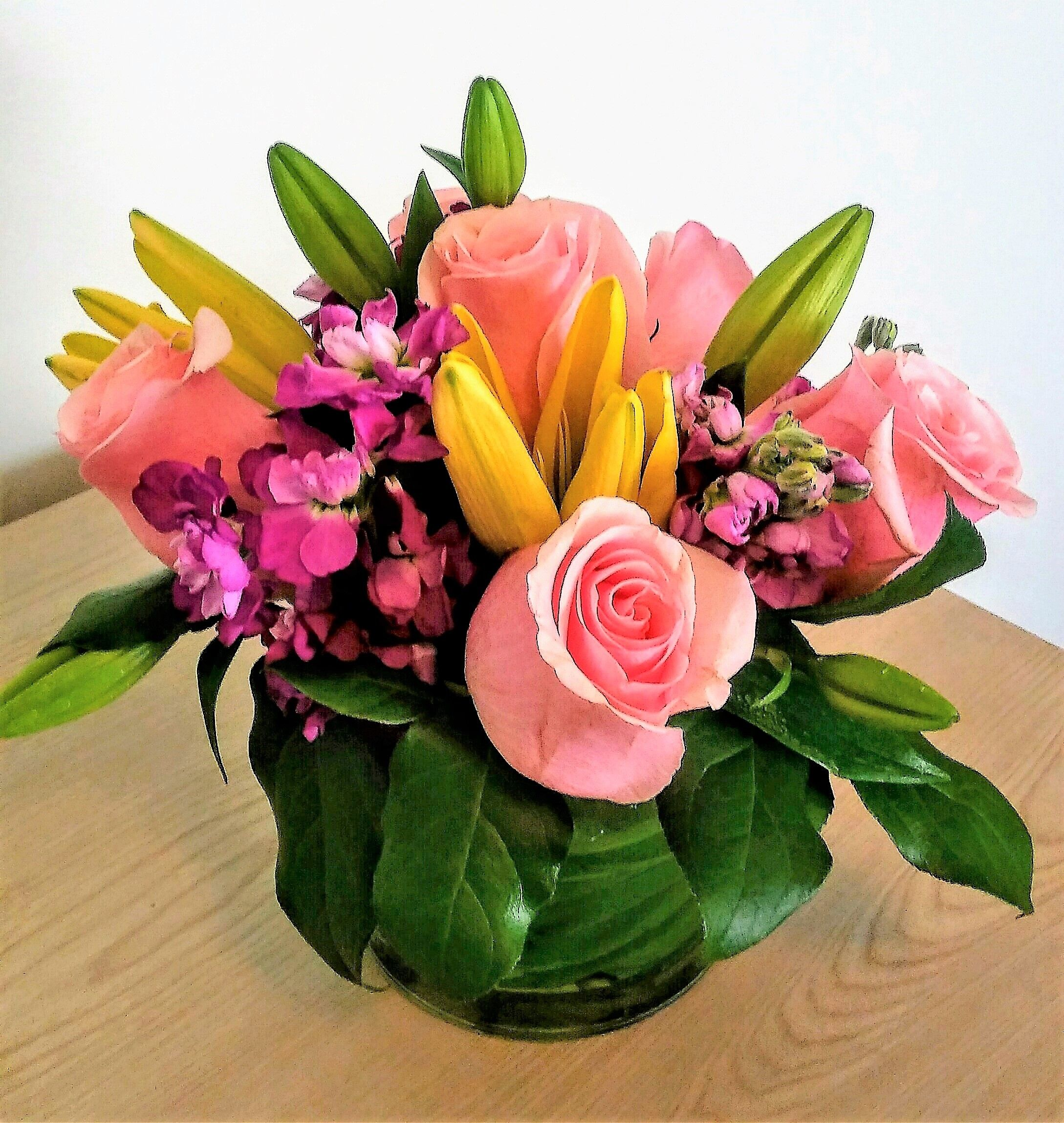 Blushing beauty by the yellow rose florist basket flower