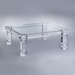"""OVERVIEW Our Bold Adrienne Coffee Table emulates luxury design. The 4"""" thick legs make a solid impact. PRODUCT DESCRIPTION 4"""" thick legs 1/2"""" thick glass inset top Custom dimensions available Also available as a Dining Table 42""""L x 42""""D x 16""""H"""