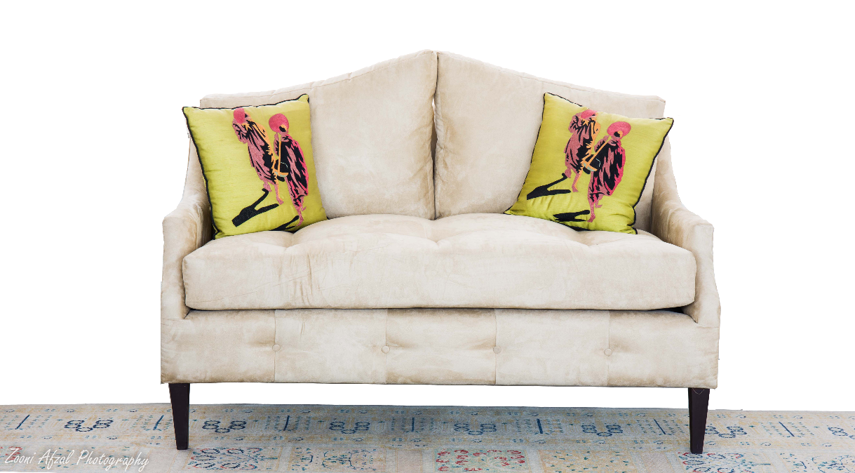 Extreme luxury suede sofa with monk themed cushions featured on a