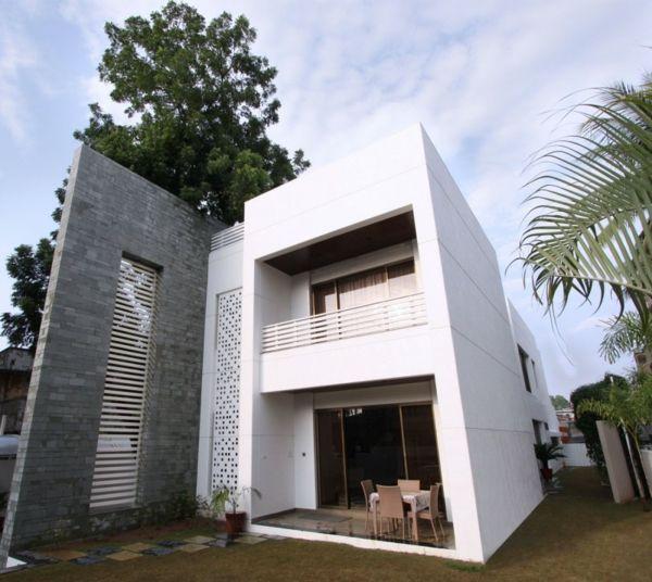 Minimalismus Blockhaus Natursteinwand