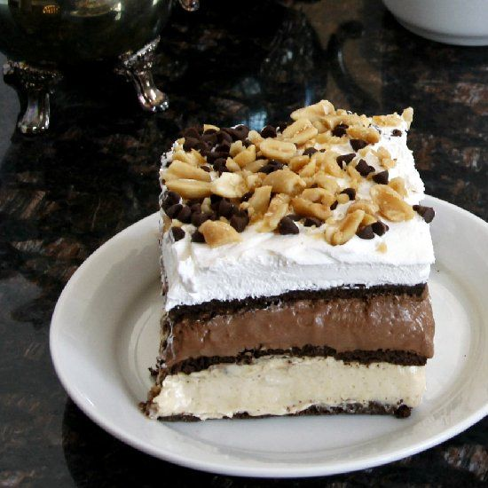 No-Bake Peanut Butter Chocolate Lasagna is easy to make and perfect Valentine's Day, holiday, or potluck dessert!