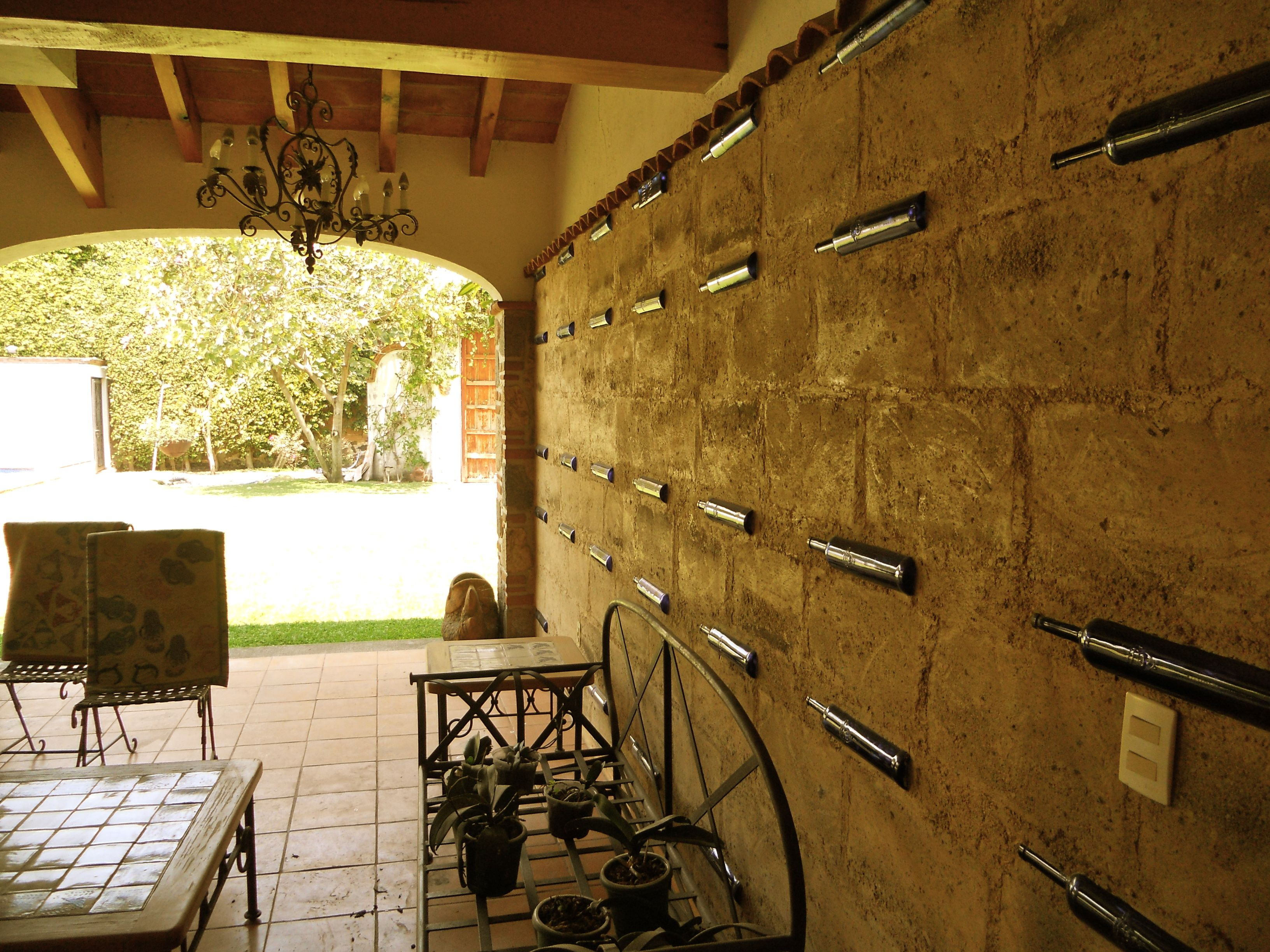 empty tequila bottles cemented into the wall for decoration | design ...