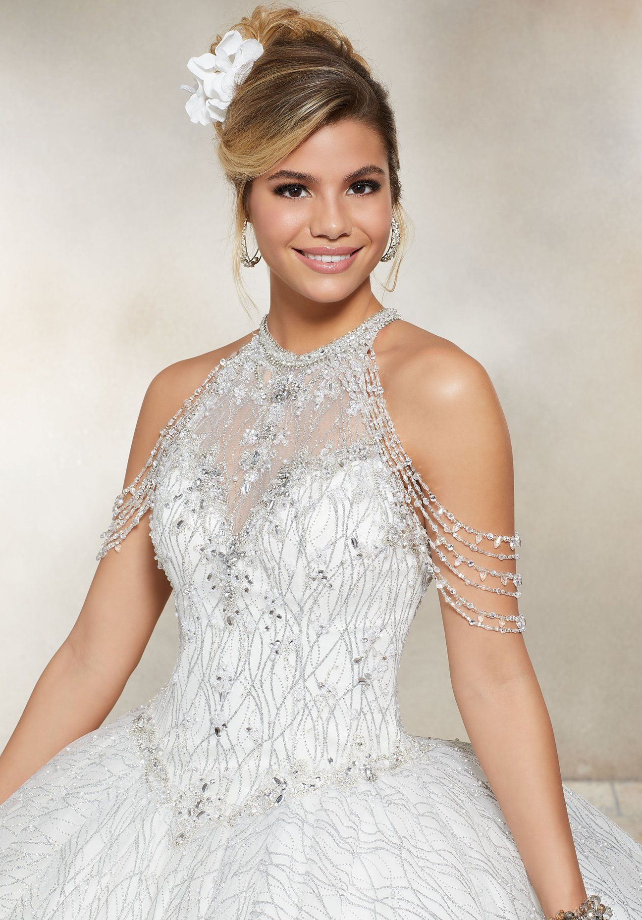 d6d3ee2c3a2 Quinceanera Dress Crystal Beading on a Patterned Glitter Mesh Ballgown