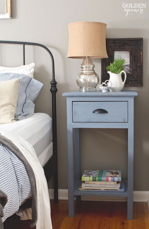 Black iron Ikea bed frame and DIY blue nightstand in rustic cottage ...