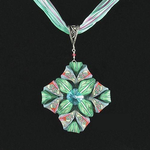"Nouveau-Inspired pendant  ·  (Size: 2.5"" (pendant), 18"" (neck strap))  ·  $160polymer clay, Swarovski crystal, sterling silver, shibori-dyed silk"