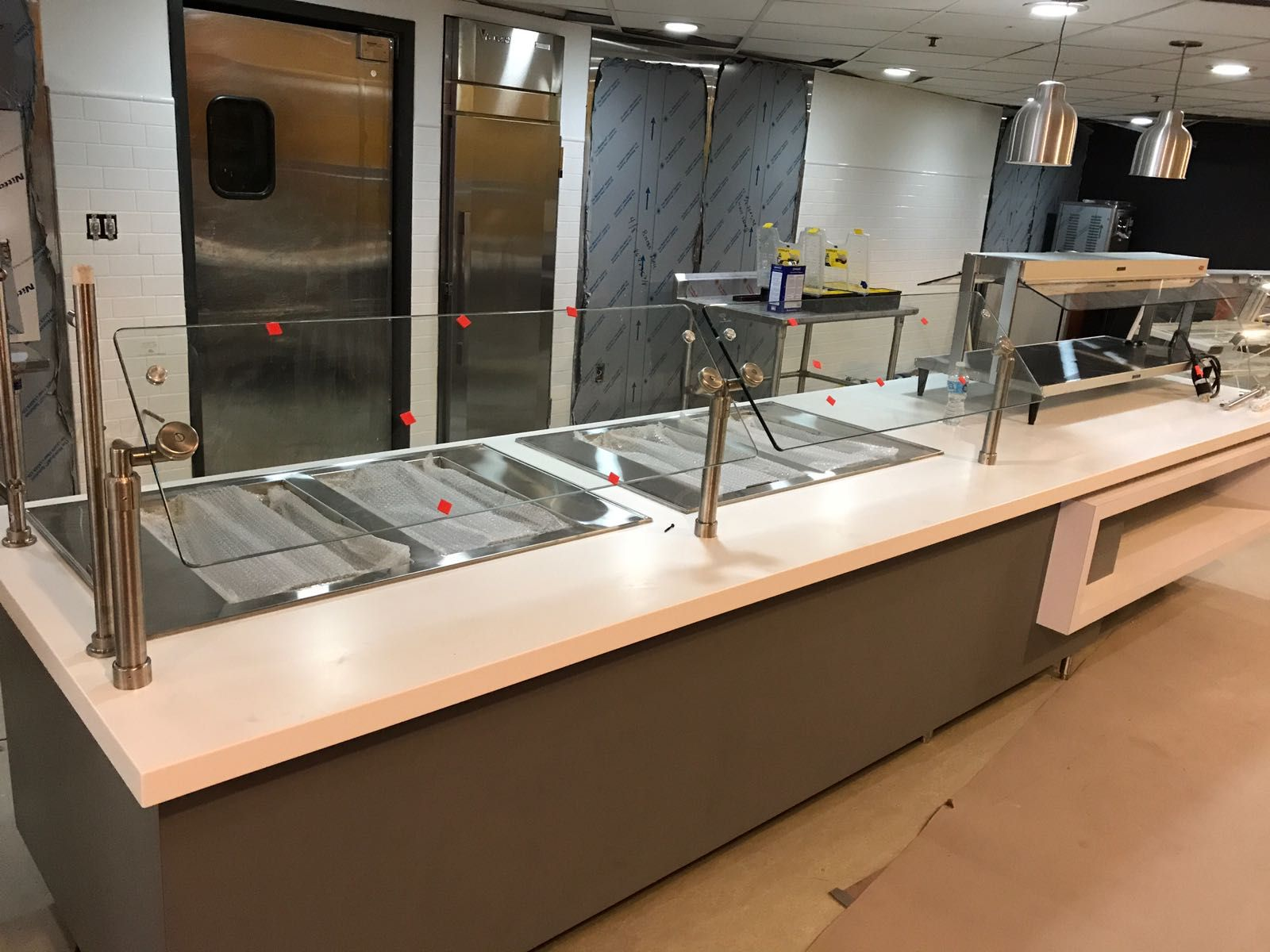 A New Cafeteria Line With Countertop Food Display Units And Hot