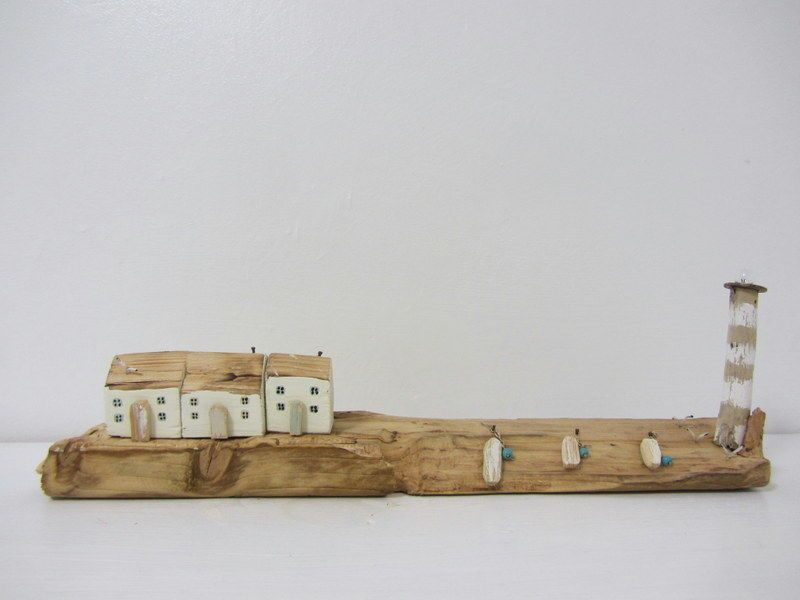 handmade driftwood cottages with lighthouse driftwood ornament