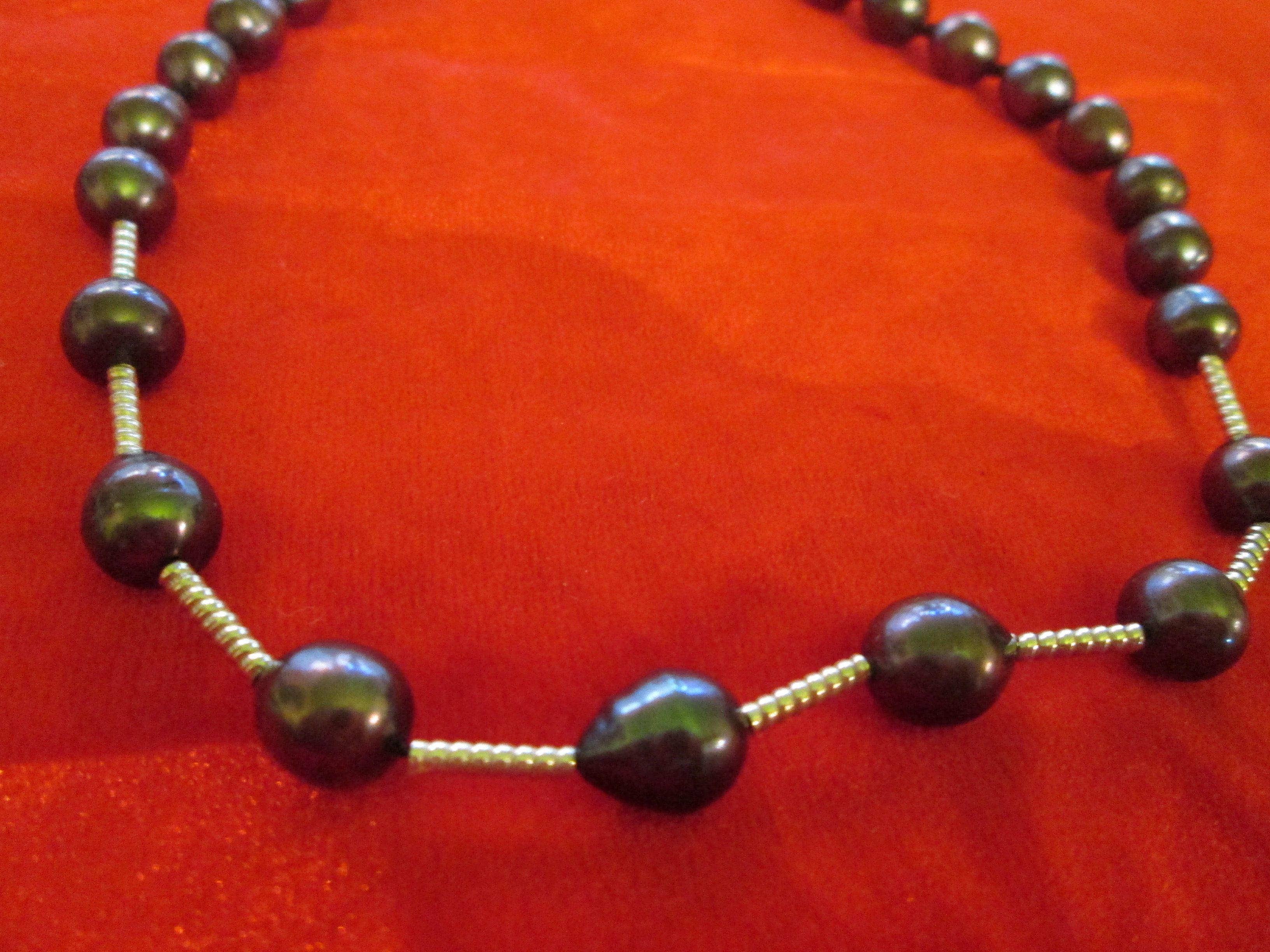 Perlas negras y plata en varitas