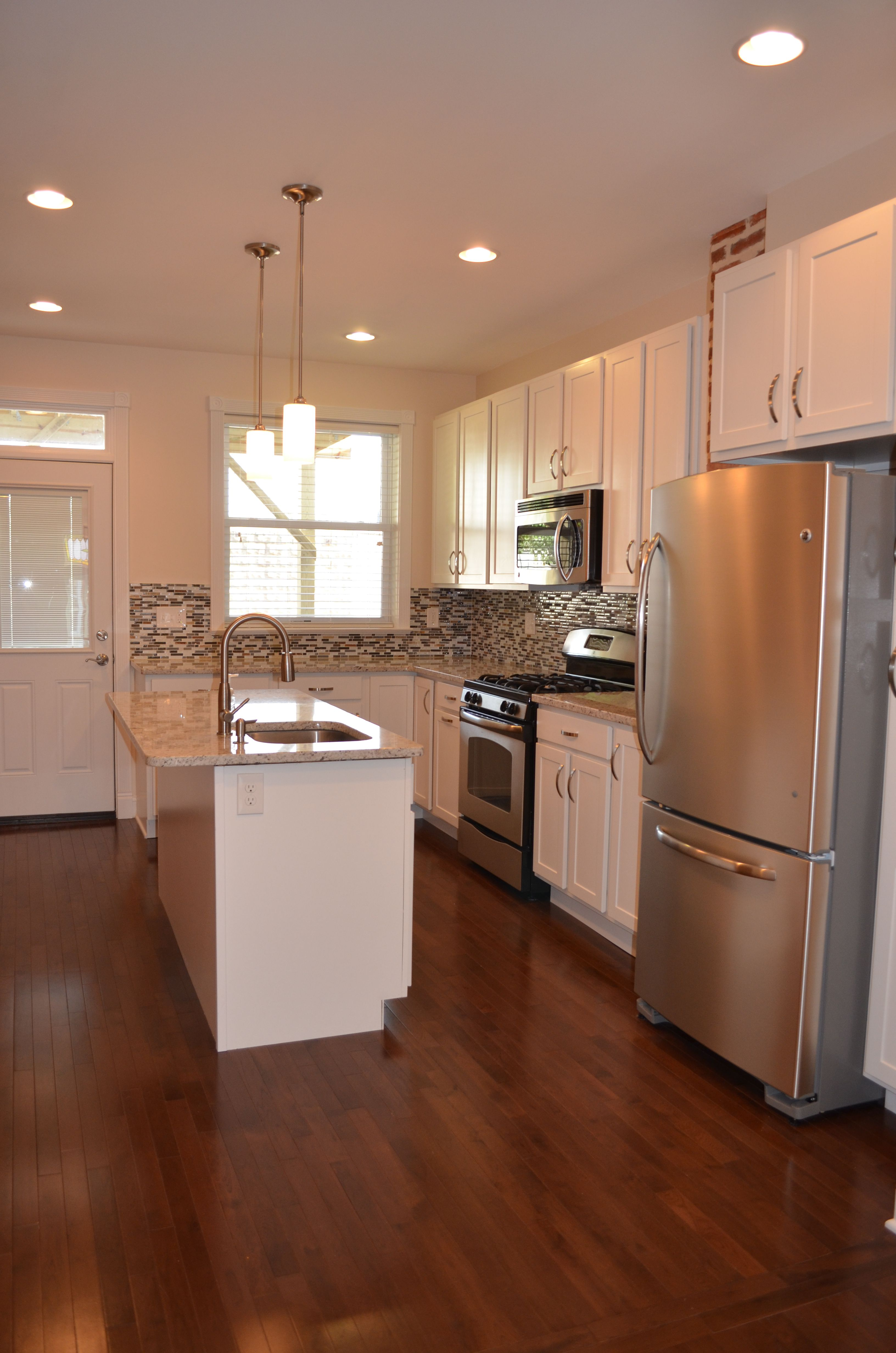 Row home kitchen renovation. Sink in island, granite ...