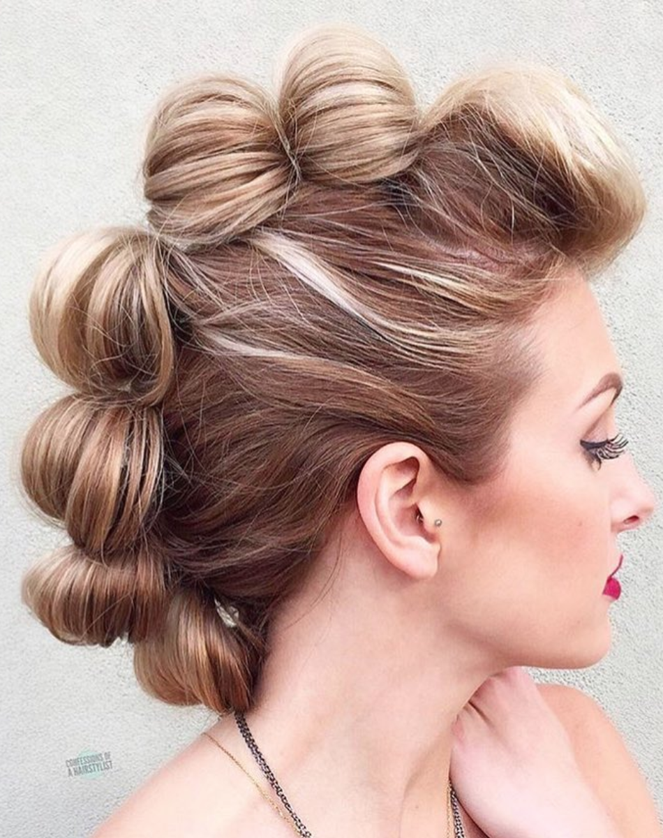6 Effortless Updos You Can Rock With Short Hair It Doesn T Matter If You Re Looking For A Chic Elaborat Faux Hawk Hairstyles Rock Hairstyles Funky Hairstyles