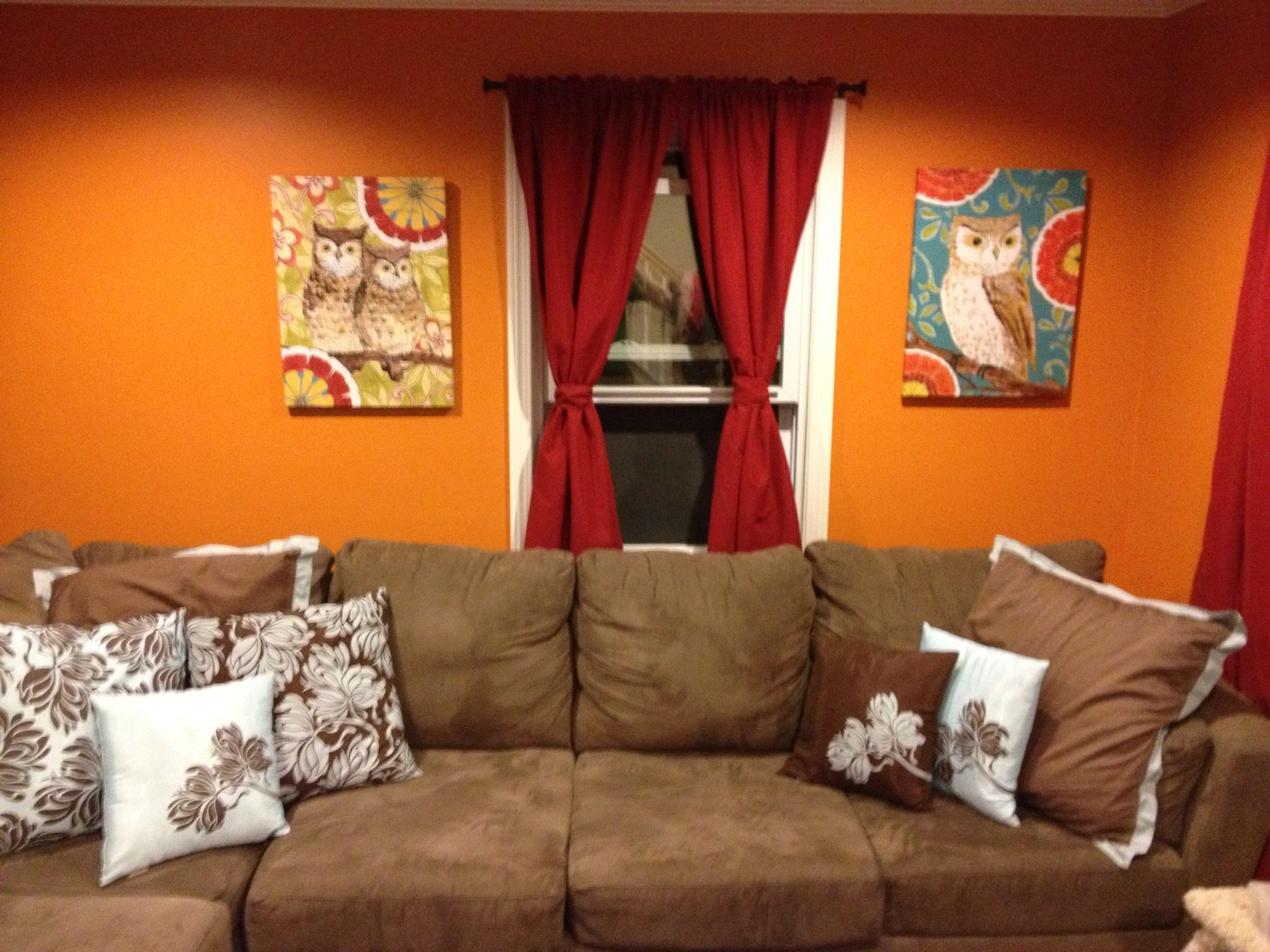 Beautiful Living Room With Brown Velvet Sectional Sofa And Chic Pillows As Well Sweet Canvas Portray Hang On Orange Wall Painted Also Red To