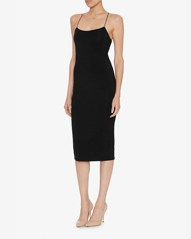 T by Alexander Wang Strappy Tank Dress: Black: Thin elastic double banded straps cross at back. Slash cut at lower back. In black. Fabric: 97% modal/3% spandex Made in Vietnam.  Model Measurements: Height 5'10 1/2; Waist 24 ; Bust 31 wearing size S Length from shoulder to hem: ...