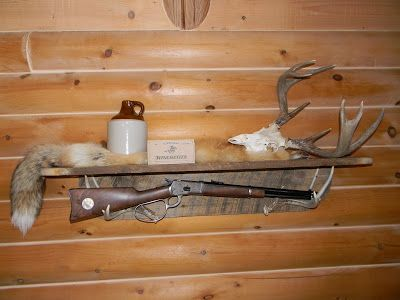 antler shelf with reclaimed wood w/ antique gun (only, I'd display some photos on it instead)