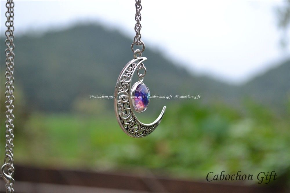 steampunk moon and galaxy necklace jewelryPS: Diameter refers to the size of the middle picture charm size.Item number: N815Picture size: 12mm in diameterMoon size: 32*38mmChain length: 70cm/27.5 inch..