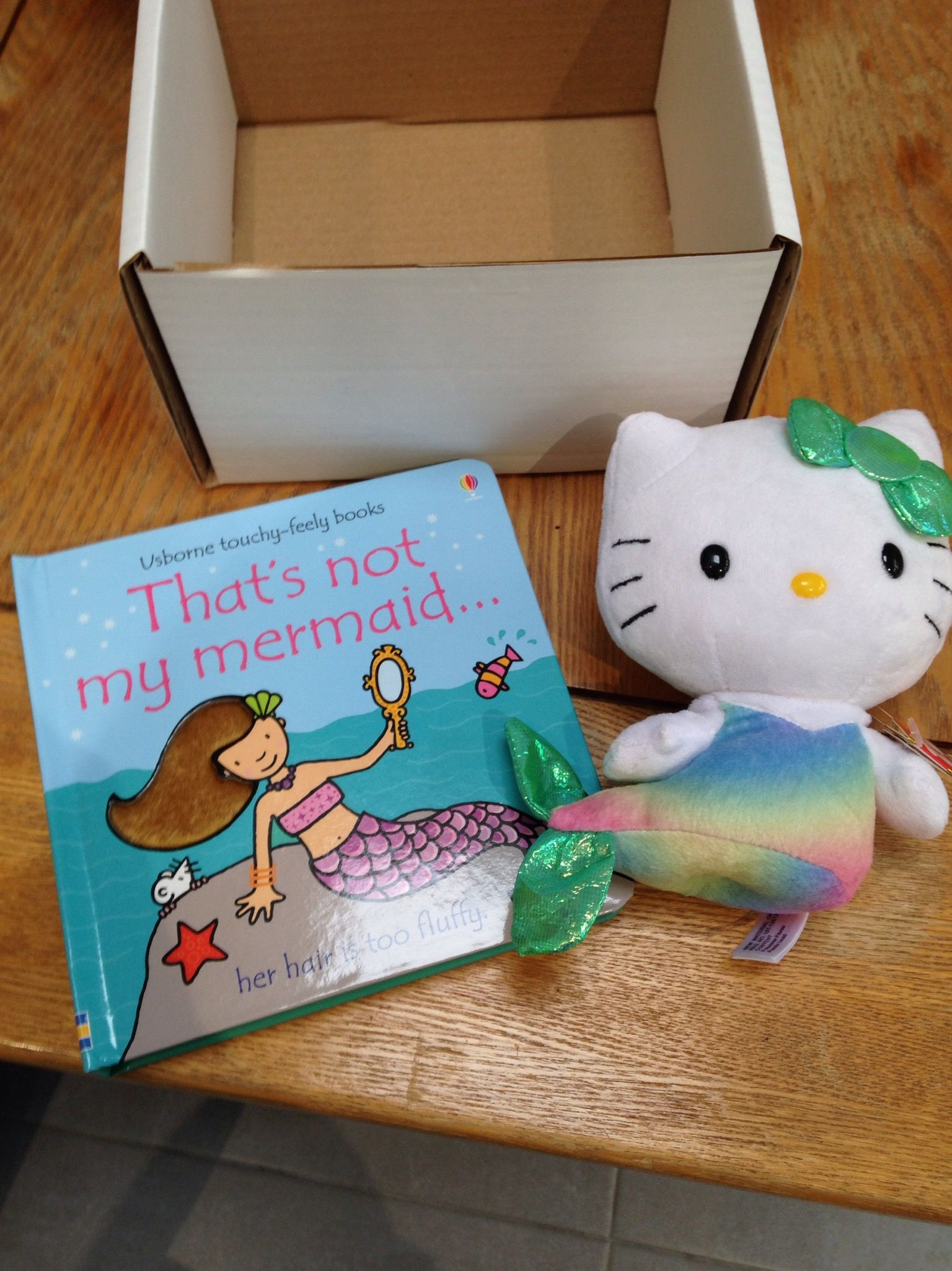 That s not my mermaid book and Hello Kitty mermaid soft toy