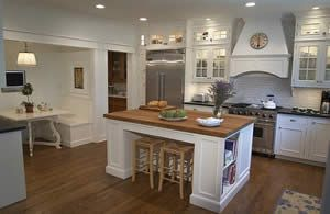 warm floors white cabinets stainless steel white walls