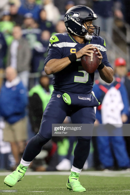 Russell Wilson Of The Seattle Seahawks Looks To Throw The Ball In The Wilson Seahawks Russell Wilson Russell Wilson Shirtless