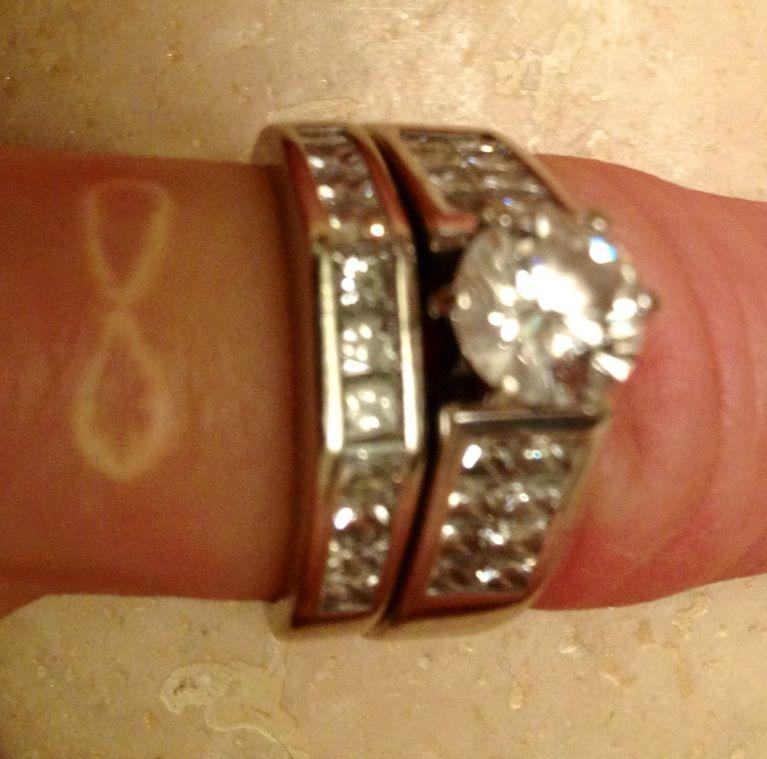 Tasteful Tiny White Wedding Ring Finger Tattoo Tattoos