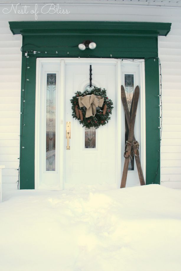 Christmas Tour -  Front Porch with antique skis and a burlap wreath