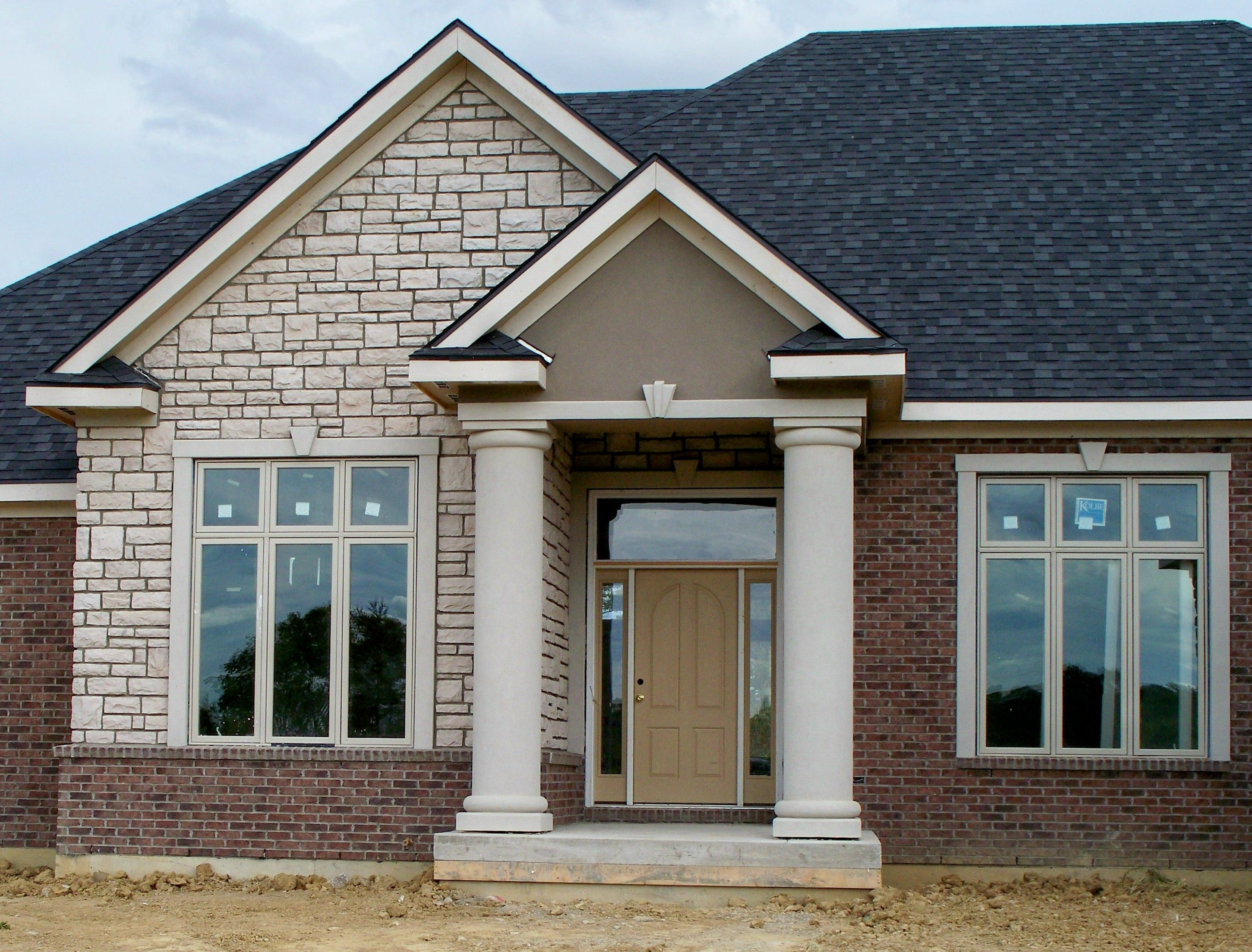 Stone and stucco homes the image kid for Stucco stone exterior designs