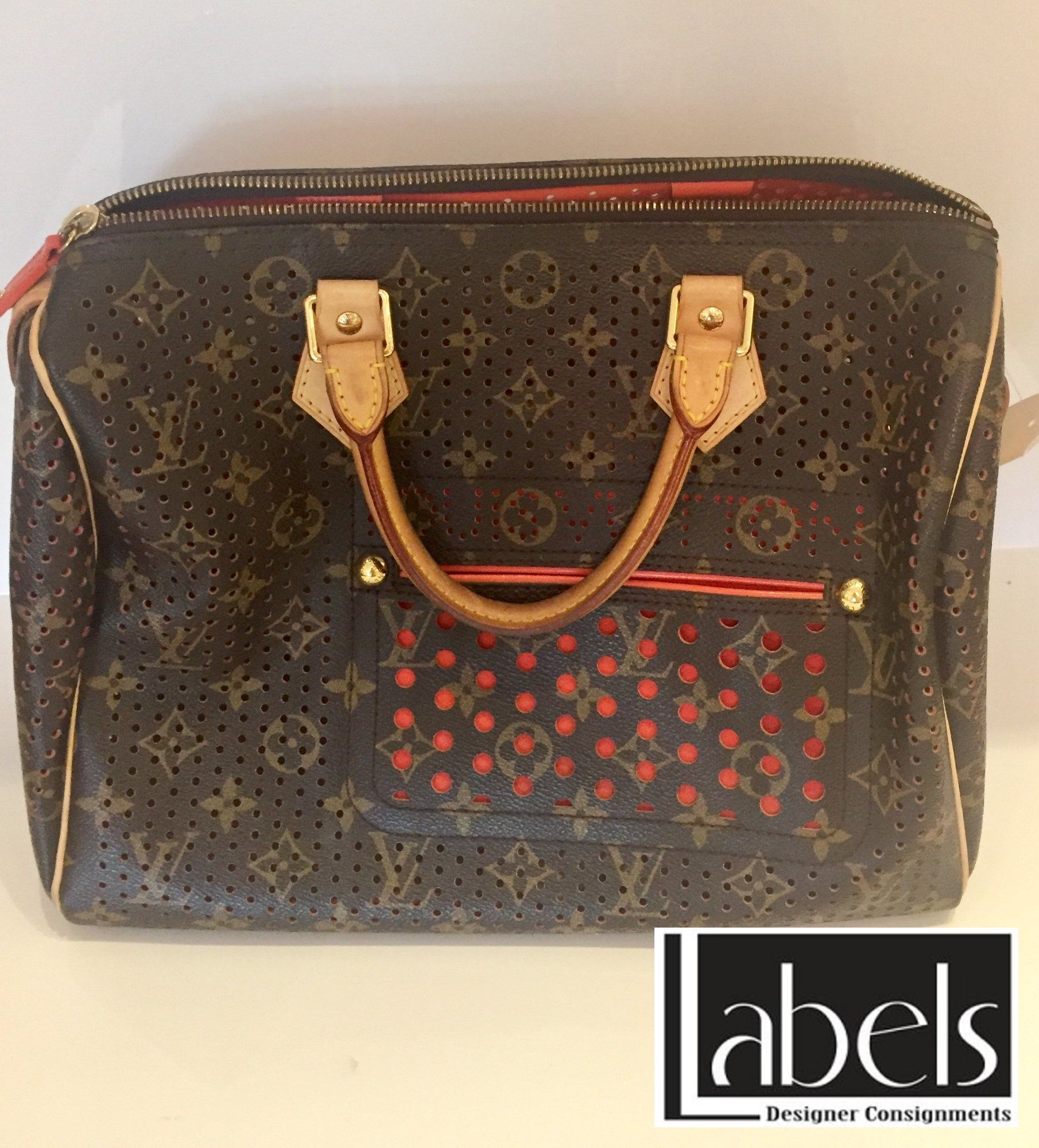79323a5c6d94 Authentic Limited Edition Louis Vuitton Monogram Orange Perforated Speedy 30  Handbag in like new condition.