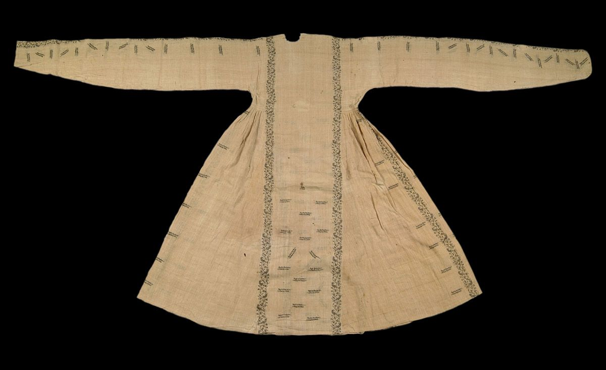 Woman's dress of woven white cotton cloth embroidered with brown thread in motifs of floral scrolls, birds and calligraphy Eastern Iranian world, 8th century AH/14th century AD 130 cm long; 47 cm wide at waist Inv. No: LNS 1096 T
