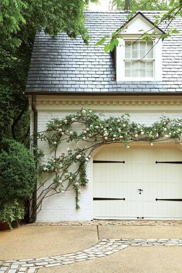 White Walls And Charcoal Slates Carriage Doors House Garage