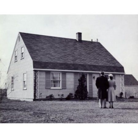 Rear view of a man and a woman standing in front of a house Canvas Art - (18 x 24)