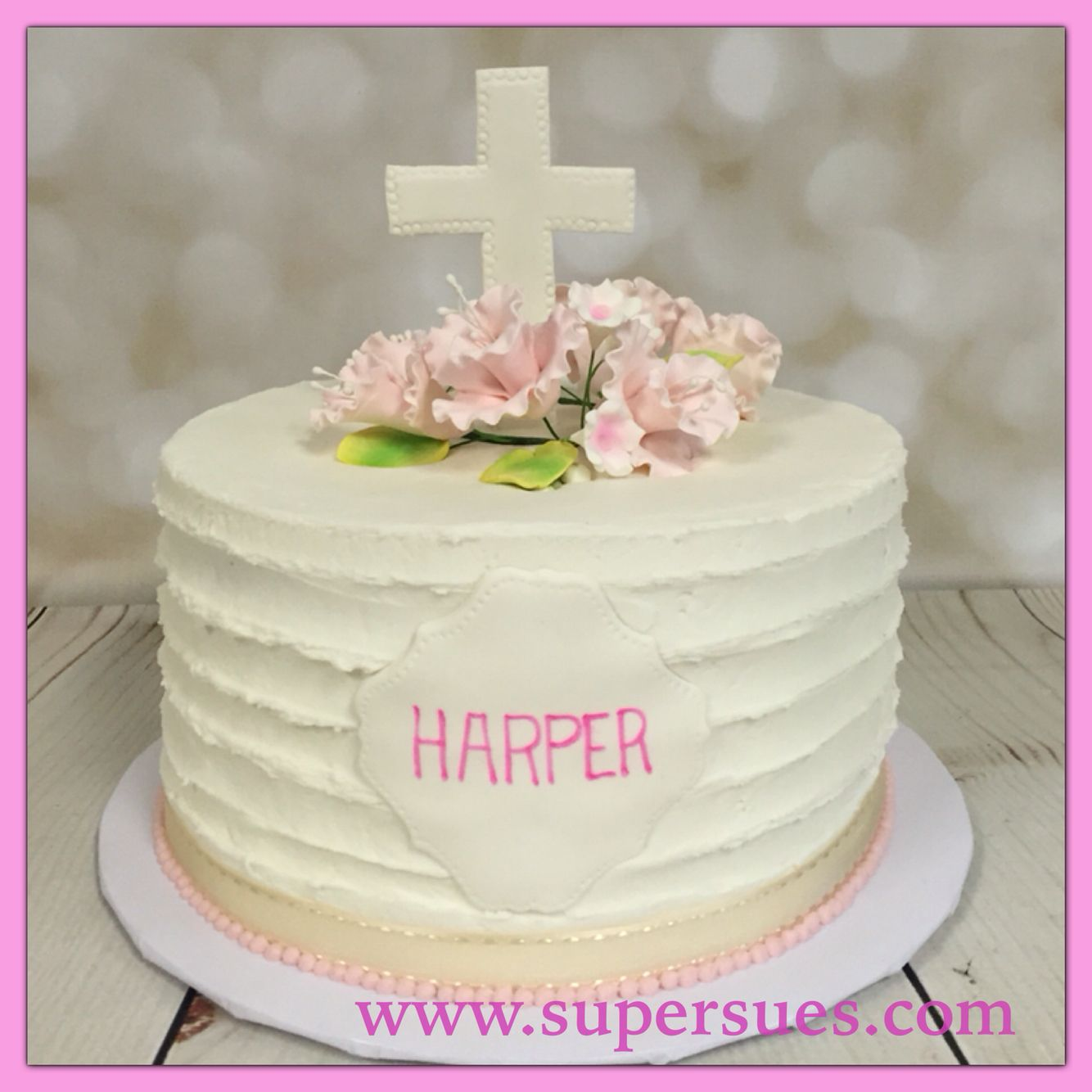 Baptism cake for baby girl. Pink sugar flowers and fondant