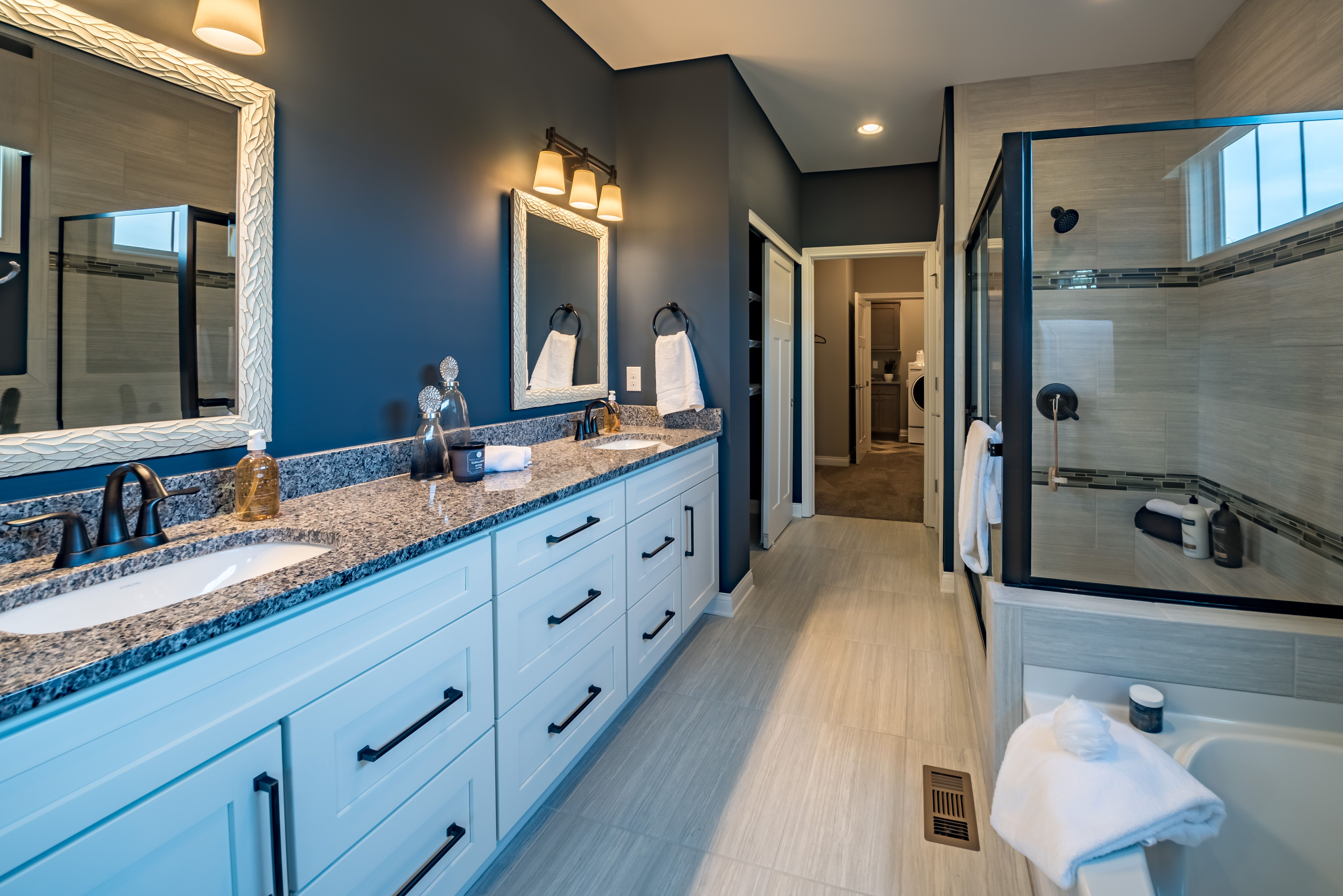 The master bathroom in this new home features a double bowl vanity ...