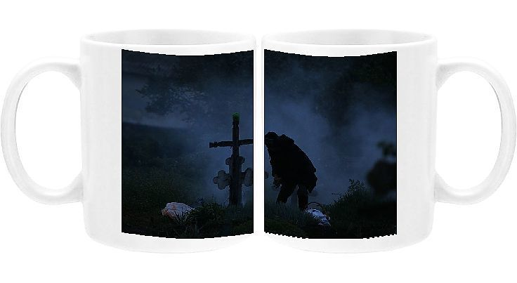 Photo of Photo Mug-Woman burns incense in front of the graves of her relatives at a cemetery in the village-11oz White ceramic mug made in the USA
