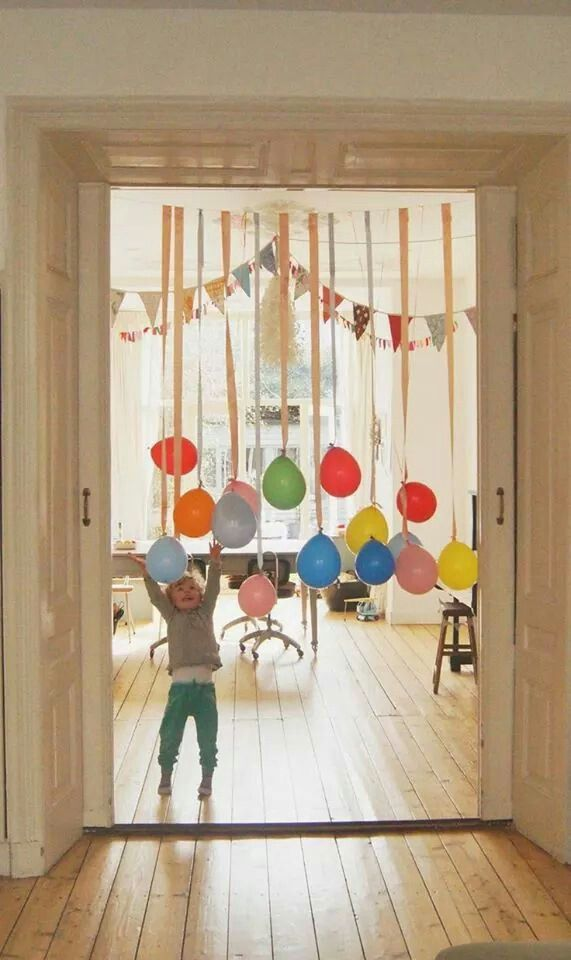 Ballooons tied to streamers dangling from a string, no Helium ...