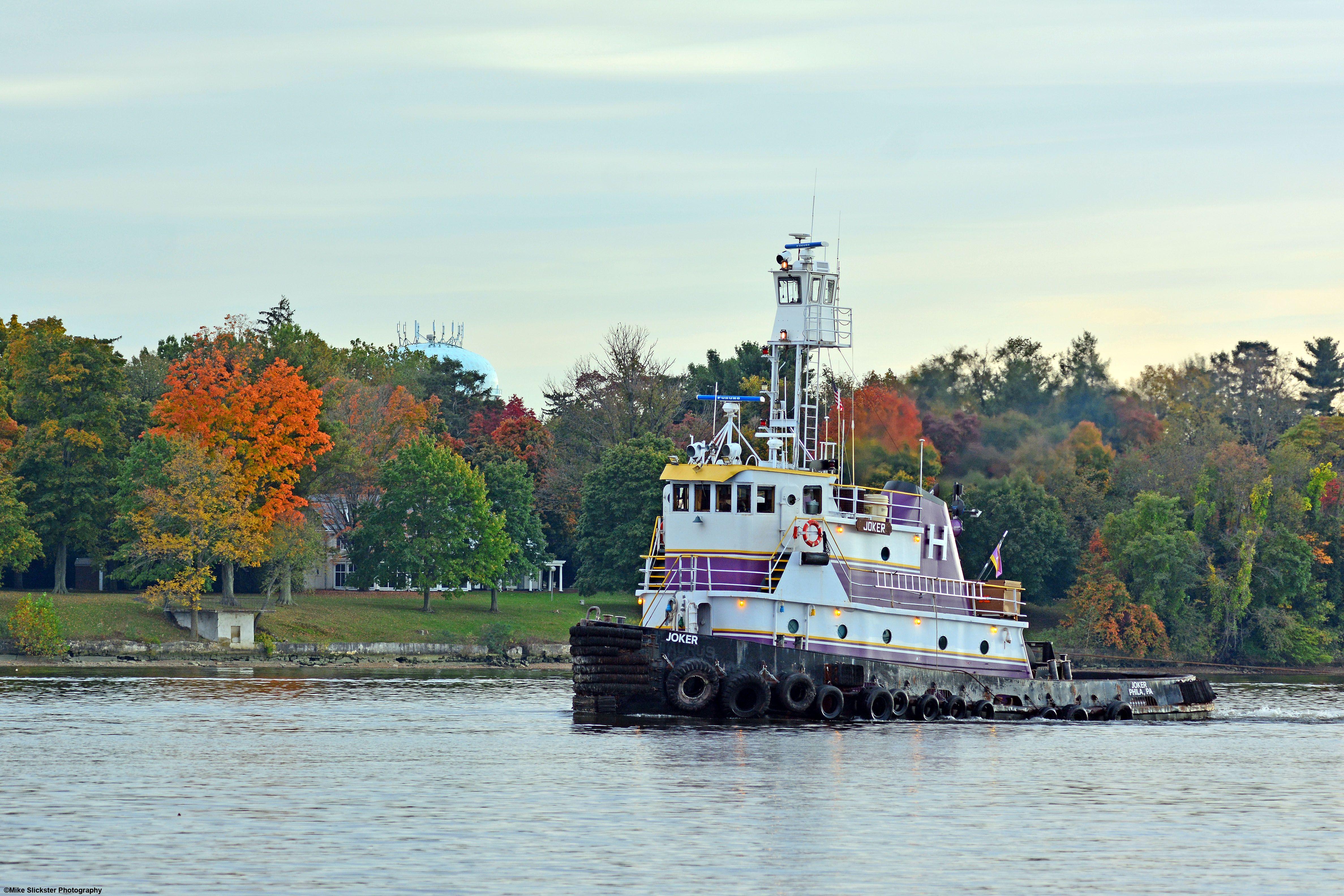 Tugboat Joker out of Philadelphia, towing a line of dredging
