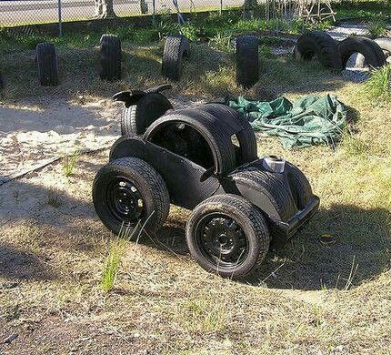 Toy cars from old tires awesome automobile tire art for Old tire art
