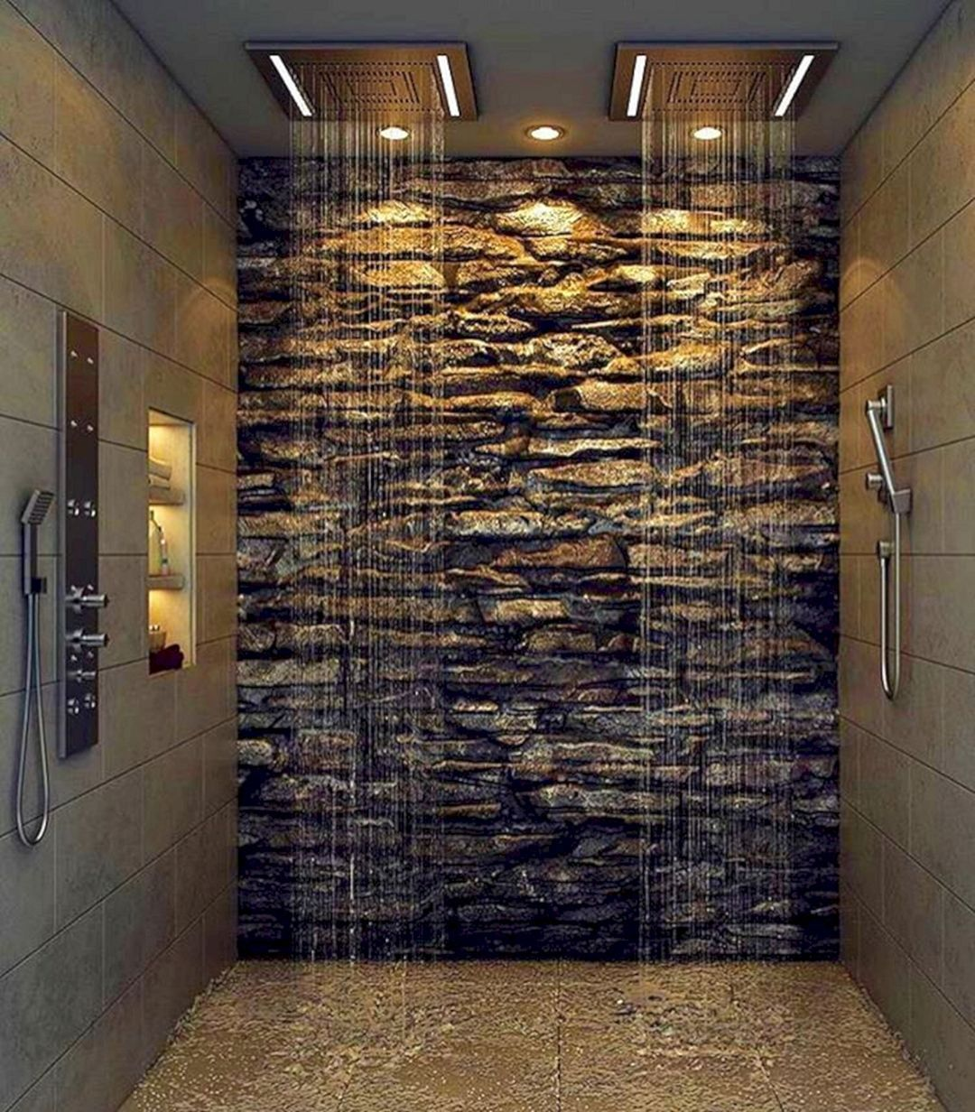 Tile Shower Featuring A River Rock Floor With A Marble Like Wall