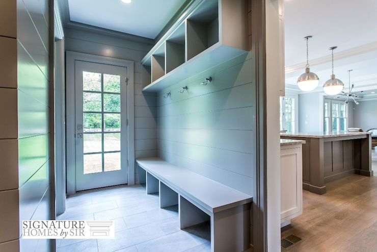 Fabulous Mud Room Off Kitchen Features Oversize Gray Tiled Floors And Gray Shiplap Paneling