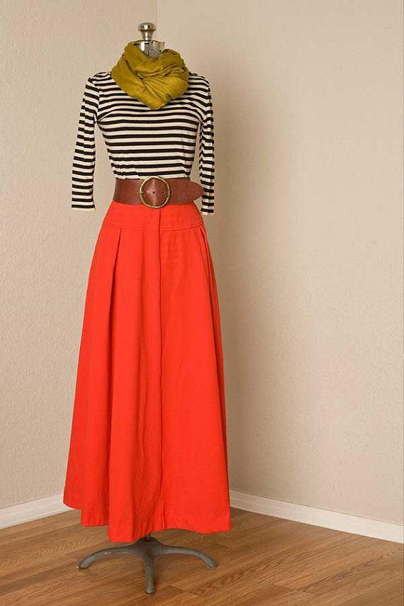 fb65faea9d -This 1970's, vintage bright red high waisted maxi skirt features 4 pleats,  2 in the front and 2 in the back, a drop-waistline seam, an accent seam  down the ...