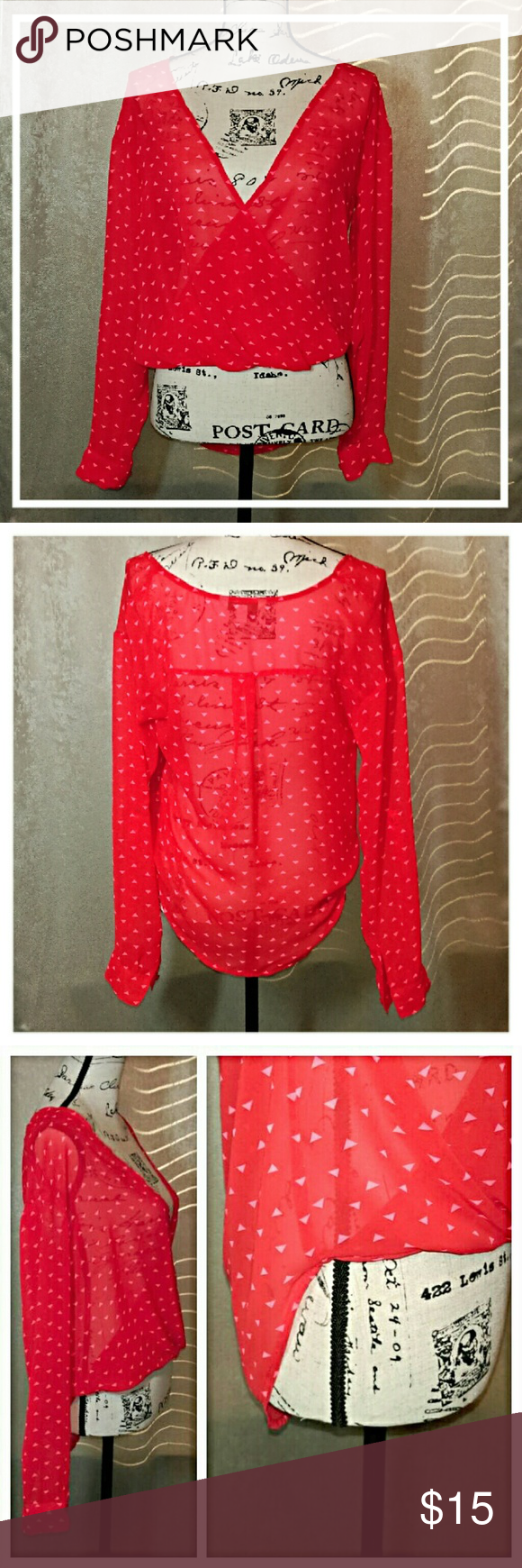 Fun Bright Red Sheer Blouse Wrap style front that folds under at the bottom in the front and hangs longer in the back. Cute tiny triangle print all over. Sleeves have button closure at wrist and also fold up to 3/4 sleeve with built-in in strap and button. Excellent Condition! No rips or snags. Decree Tops Blouses