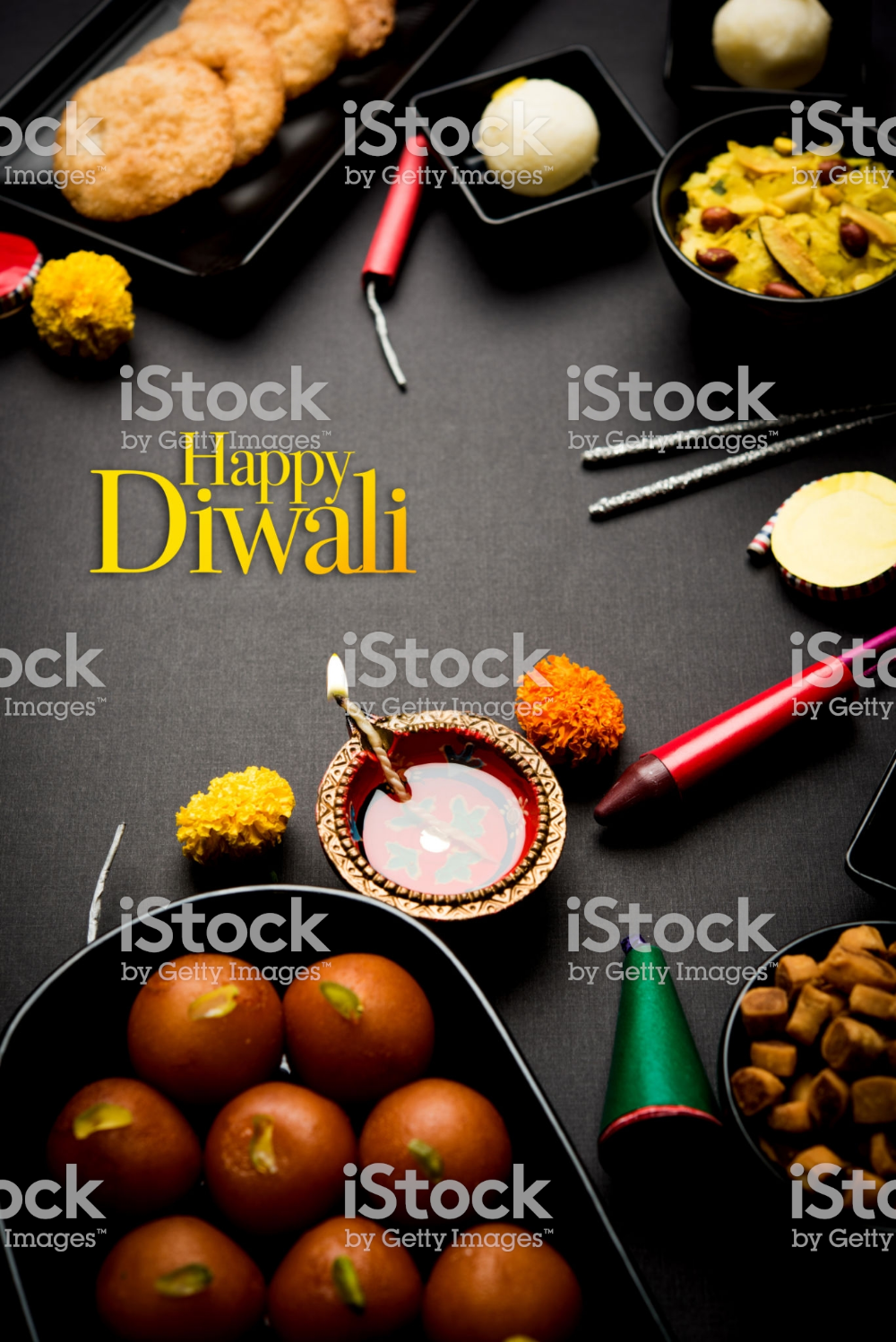 Happy Diwali Greeting Card made using sweets, or fire crackers or...