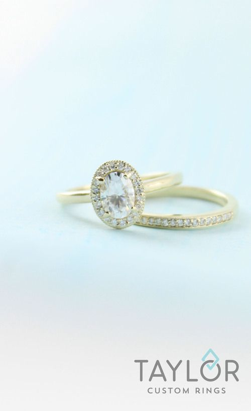Yellow Gold oval with halo and wedding band.