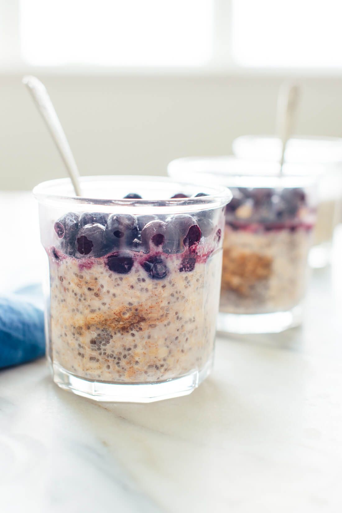 This is a healthy and delicious breakfast! Overnight oats with blueberries and almond butter (gluten free and vegan) - cookieandkate.com
